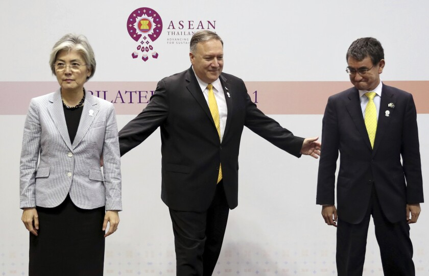 Kang Kyung-wha of South Korea, left, Mike Pompeo, and Taro Kono of Japan at the ASEAN foreign ministers' meeting in Bangkok, Thailand, on Aug. 2.