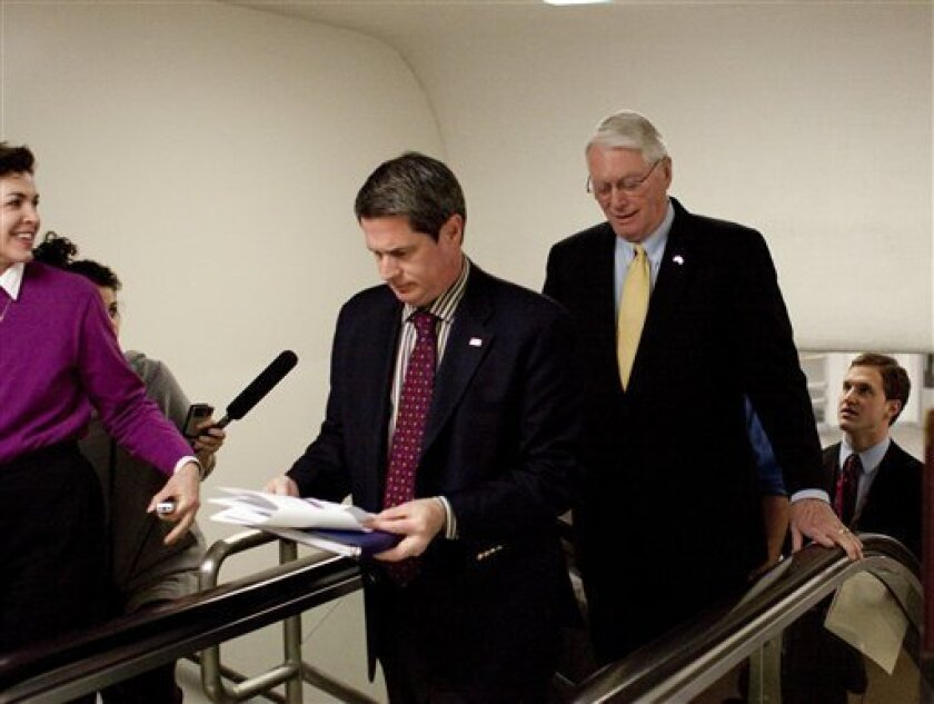 Sen. Jim Bunning, R-Ky., center, follows Sen. David Vitter, R-La., as they head to the Senate floor on Capitol Hill in Washington, Tuesday, March 2, 2010. (AP Photo/Harry Hamburg)