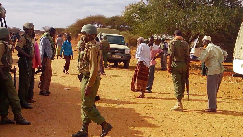 EDS NOTE : Photos taken with mobile phone---Kenya army soldiers patrol at street in Mandera, Kenya, Friday July 1, 2016, after gunmen, thought to be from the al-Shabab group according to a Kenyan official, killed at least six people when they shot at two buses traveling in northern Kenya.  U.S. gov
