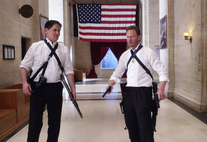 """Mark Cuban, left, plays the president and Ian Ziering returns for a third adventure as Fin Shepard in """"Sharknado 3: Oh Hell No!"""" on Syfy."""