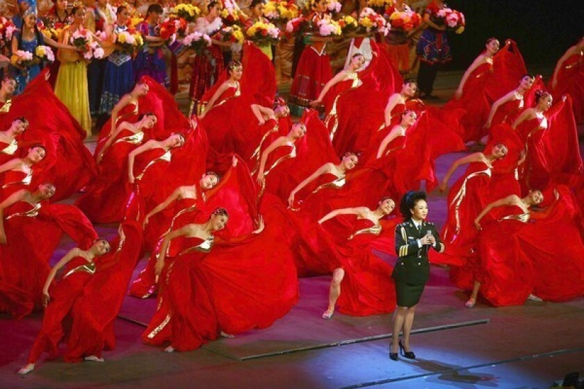 Peng Liyuan sings during a national gala honoring the Chinese army in 2007. Her husband, Xi Jinping, is soon to become president of China.