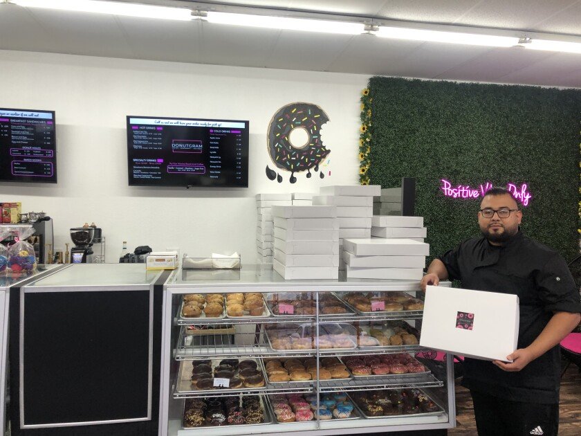 Baker Francisco Guevera inside newly opened Donutgram doughtnut shop in Escondido, which he owns with his mom, Virginia, and sister, Mitzi.
