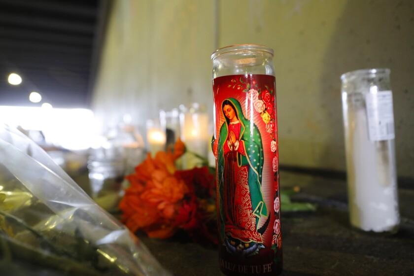 Candles burn at a makeshift memorial