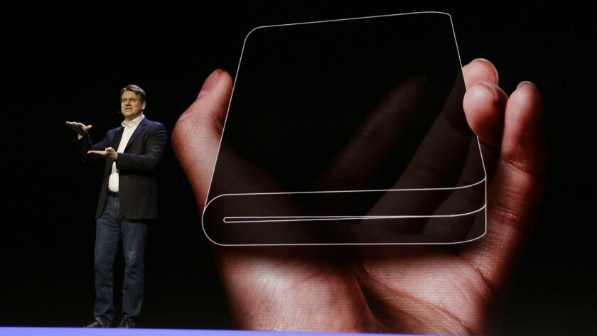 Samsung executive Justin Denison talks about the Infinity Flex Display folding smartphone at the Samsung Developer Conference in San Francisco.