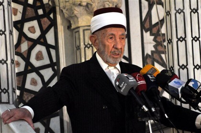 In this undated photo released by the Syrian official news agency SANA, Sheikh Mohammad Said Ramadan al-Buti, an 84-year-old cleric known to all Syrians as a religious scholar, speaks at a press conference. Al-Buti, a top Sunni Muslim preacher and longtime supporter of President Bashar Assad was ki
