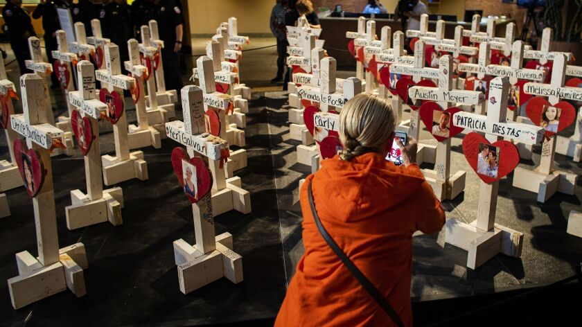 LAS VEGAS, NV - OCTOBER 1, 2018: Crosses bearing the names and photos of the 58 people killed in the