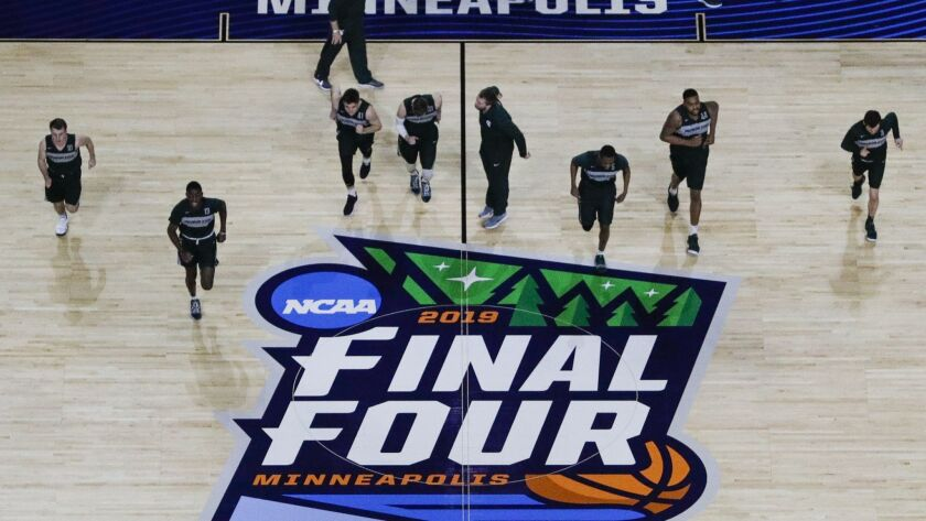 Michigan State players warm up during a practice session for the semifinals of the Final Four NCAA c