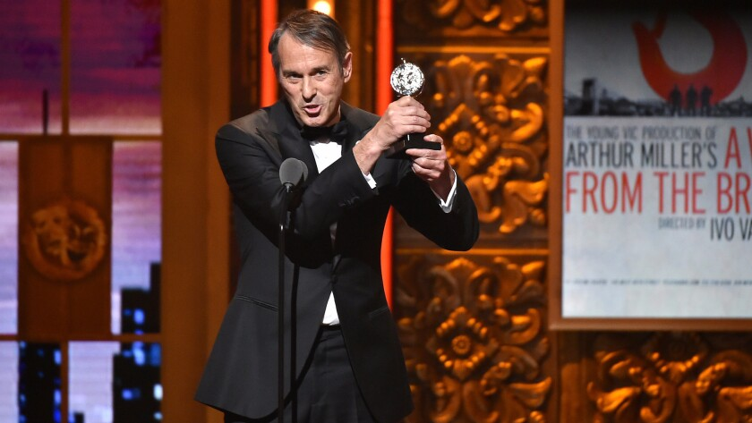 "Director Ivo van Hove accepts the Tony Award for direction of a play for ""A View From the Bridge"" in New York on June 12."