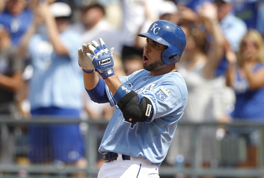 Kansas City Royals' Omar Infante reacts after scoring the go-ahead run in the seventh inning of a baseball game against the Detroit Tigers at Kauffman Stadium in Kansas City, Mo., Sunday, July 13, 2014. (AP Photo/Colin E. Braley)