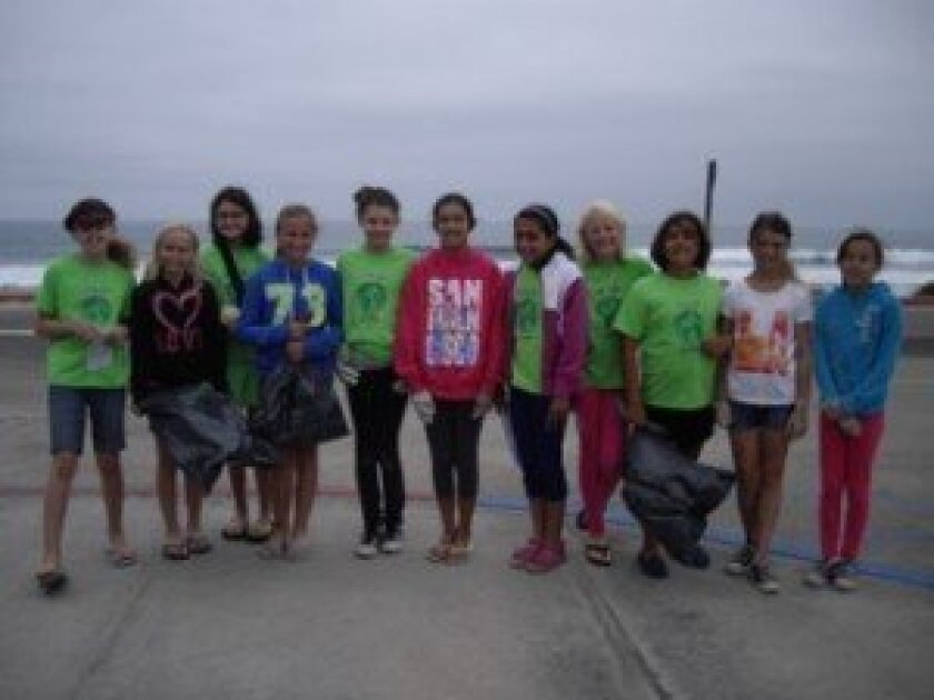 Girls Go Green members recently participated in a beach cleanup. Courtesy photo