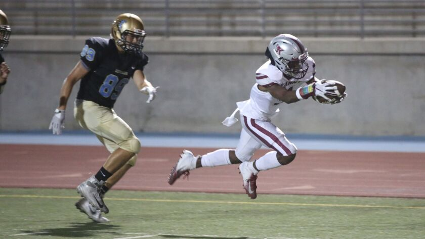Kearny wide receiver Xavier Tate dives for a first down against San Ysidro.