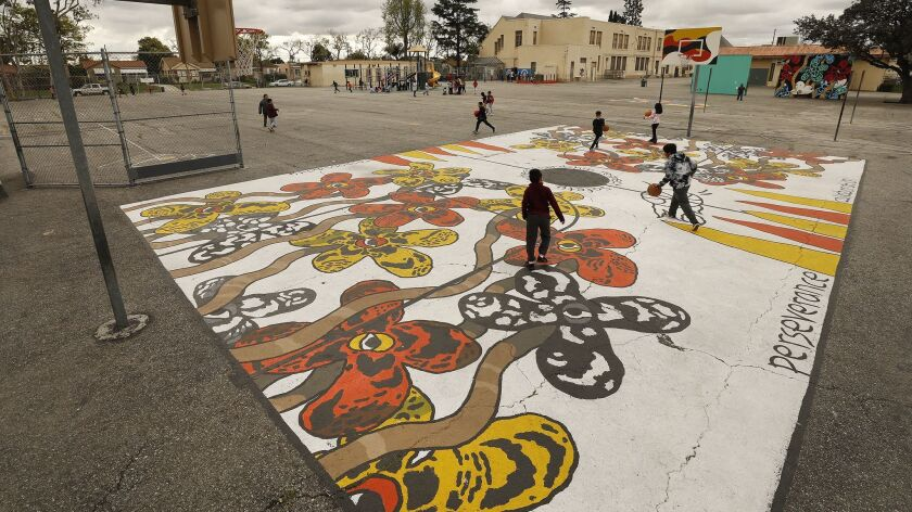 LOS ANGELES, CA - APRIL 4, 2019 - Third grade students play during recess on the 59th Street Element