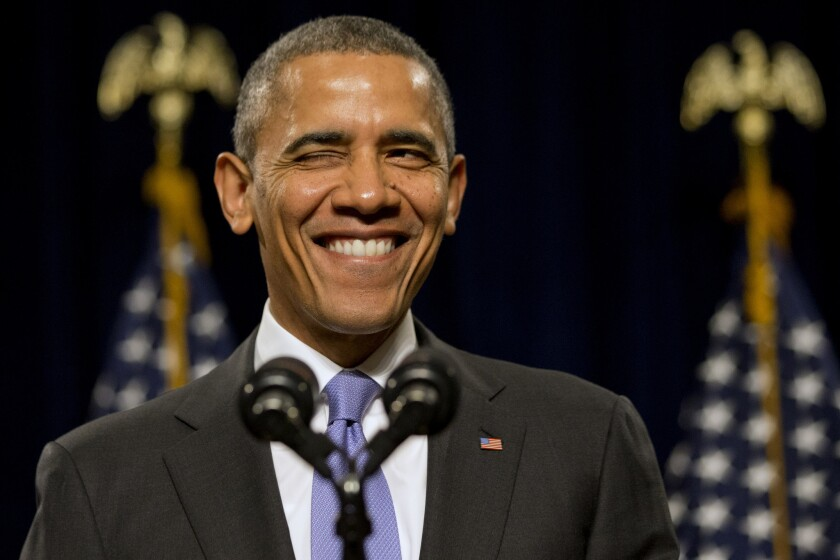 President Obama winks as he is welcomed before speaking to the House Democratic Issues Conference in Cambridge, Md. Obama said top priorities for Congress should be increasing the minimum wage and reforming immigration.