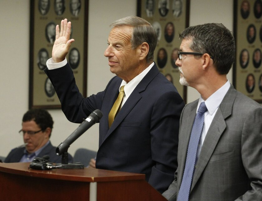 Former San Diego mayor Bob Filner (center) stands with Earll Pott, a member of his defense team, in court in October just before he pleaded guilty to felony false imprisonment and two misdemeanor counts of battery.