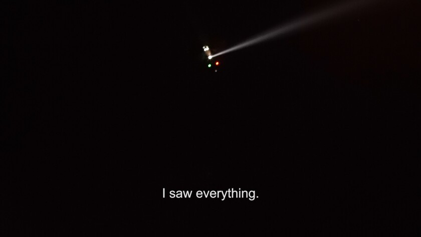 A still from a video work by Guadalupe Rosales shows a helicopter in a night sky