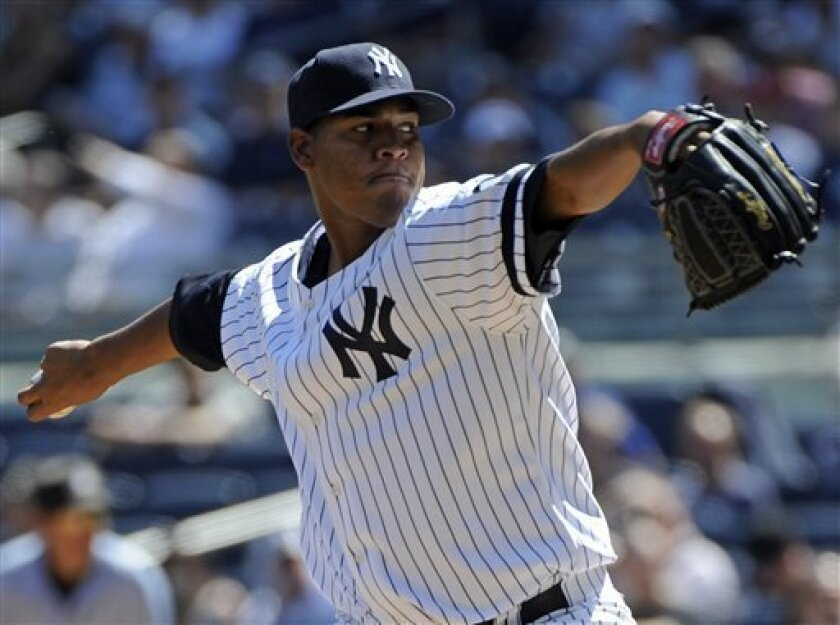 New York Yankees pitcher Ivan Nova throws against the Baltimore Orioles during the first inning of a baseball game Wednesday, Sept. 8, 2010, at Yankee Stadium in New York. (AP Photo/Bill Kostroun)