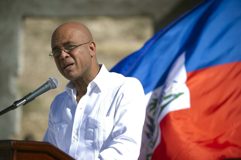 Haitian President Michel Martelly, shown at a memorial Jan. 2 in Titanyen honoring victims of the 2010 earthquake, has reportedly reached a deal with opposition leaders calling for elections this year.