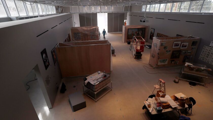 Workers prepare the Wende Museum for its opening in the renovated armory building.