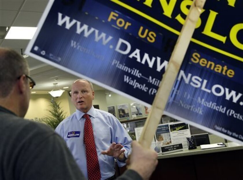 Republican U.S. Senate hopeful Dan Winslow speaks with potential voters in a bank during a tour of downtown Mansfield, Mass. Monday, April 29, 2013. Three Republicans and two Democrats seeking the nominations of their parties to run in a special U.S. Senate election are making a final pre-primary p
