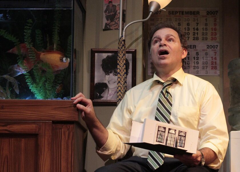 """Phil Johnson (and his aquatic friend """"Denise"""") in Cygnet Theatre's """"Mistakes Were Made."""""""