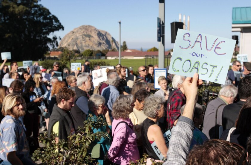 A vote on the dismissal of California Coastal Commission Executive Director Charles Lester is on the agenda at a meeting in Morro Bay. Supporters gather outside the Morro Bay Community Center before hearing Wednesday, Feb. 10, 2016. (David Middlecamp/The Tribune (of San Luis Obispo) via AP)