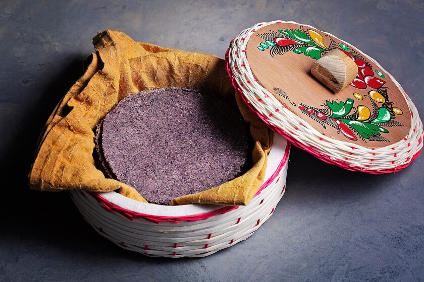 Blue corn tortillas are as easy to make at home as regular yellow corn tortillas.