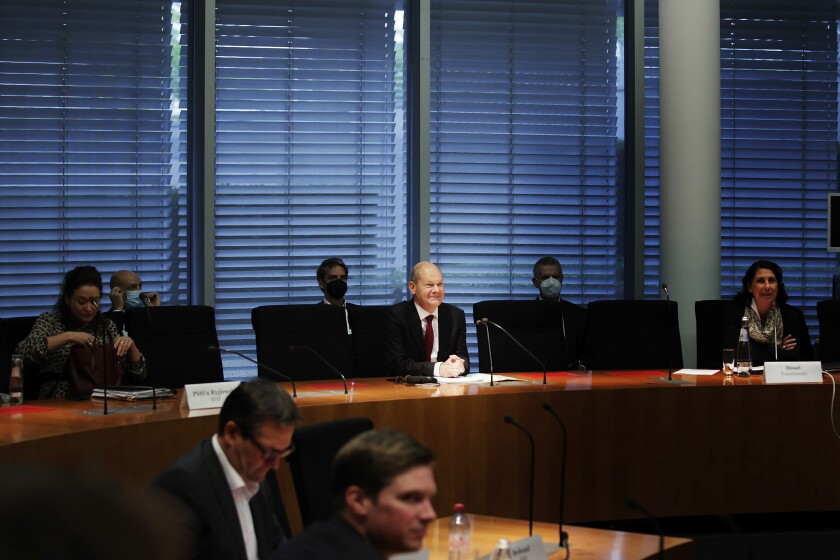 Olaf Scholz, Federal Minister of Finance and SPD top candidate for chancellor at the forthcoming General election, sits on the Finance Committee of the Bundestag in Berlin, Germany, Monday, Sept. 20, 2021. Scholz is to answer questions about the search of his ministry in connection with money laundering investigations. (Carsten Koall/dpa via AP)