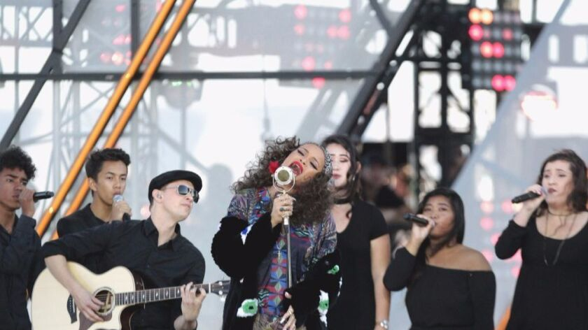 Singer Andra Day performs with San Diego School of Creative and Performing Arts students on Oct. 15 at RiseUp AS ONE concert at Cross Border Xpress concert at U.S./Mexico border near San Diego.