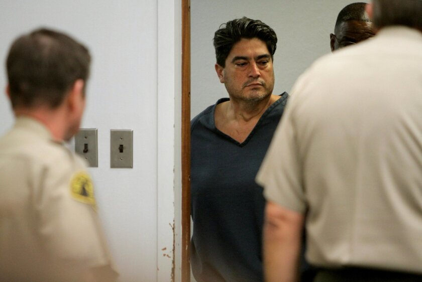 Michael David Robles, who is accused of killing his ex-girlfriend, enters Vista Superior Court on Wednesday for his arraignment. The Fallbrook man pleaded not guilty to charges of murder and a special circumstance of lying in wait.