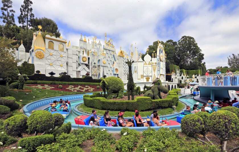 """Disneyland guests sit in boats on the """"It's a Small World"""" ride in 2015. Anaheim, which is home to the park, was the hottest place in the nation on Monday, reaching a high of 98 degrees."""