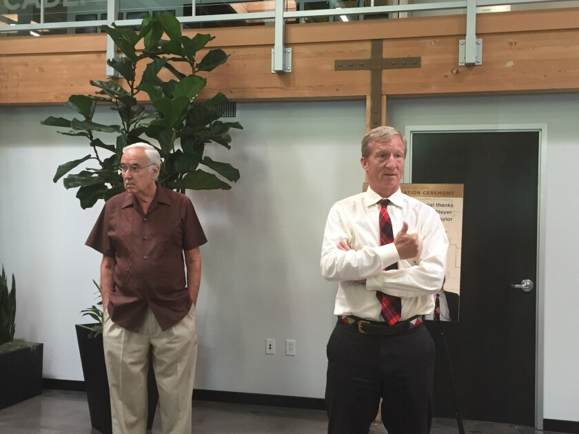 California Democratic Party Chairman John Burton, left, and environmentalist Tom Steyer speak at an event Thursday marking the LEED Gold certification of the party's headquarters.