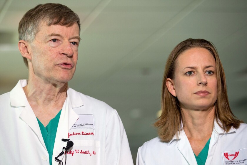 Dr. Philip W. Smith, left, and Dr. Angela Hewlett speak during a news conference Sept. 7 about the condition of Dr. Rick Sacra at the Nebraska Medical Center in Omaha on Sept. 7. Hospital officials announced this week that Sacra had received TKM-Ebola, an experimental drug from Canada.