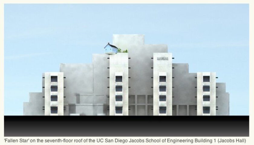 """The """"Fallen Star"""" house is a three-quarter-sized version of a small house in Providence, Rhode Island. It was erected on the seventh-floor roof of the UCSD Jacobs School of Engineering Building 1 (Jacobs Hall). The entire sculpture consists of the house, cantilevered at an angle from the corner of"""