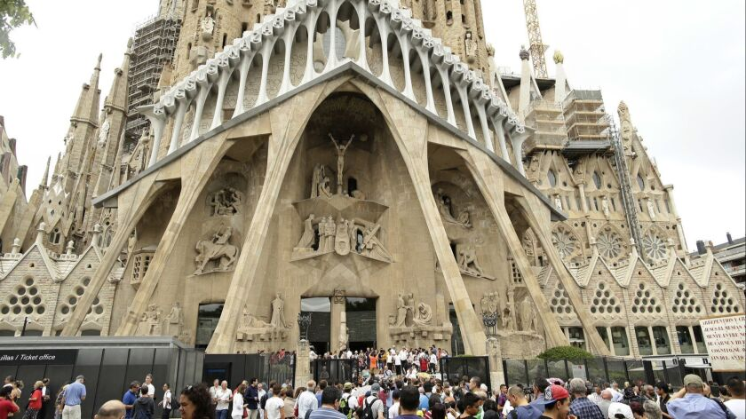 FILE - In this Sunday, Aug. 20, 2017 file photo, dignitaries leave after a Mass at Barcelona's Sagra
