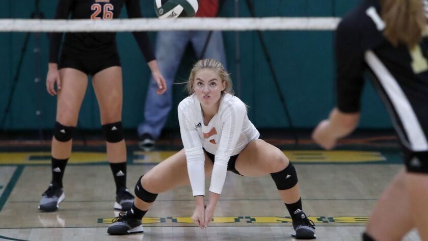 Huntington Beach High's Mia Christensen gets low for a dig against JSerra during second set in a non