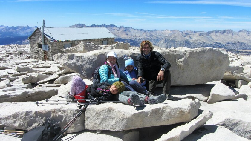 Jenna, Linda, Brin and Mike Jaffe ascend Mount Whitney in August. When Jenna, 10, and her family, reached the top, she said she 'collapsed on a rock'.