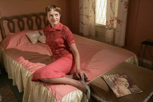 """Elisabeth Moss sits in the bedroom of her character, Peggy Olson, on the set of the AMC television series, """"Mad Men."""" """"She takes her hard knocks, but she's definitely not one to make the same mistake twice,"""" said Moss."""