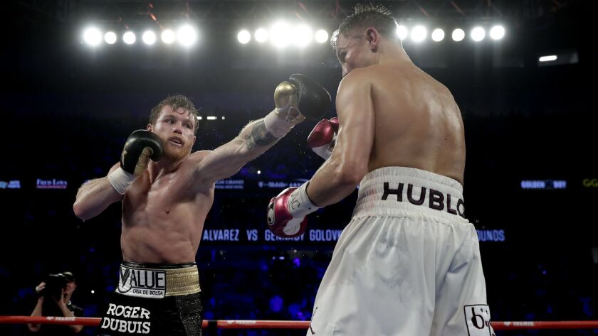 Canelo Alvarez, left , lands a punch against Gennady Golovkin during a middleweight title boxing mat