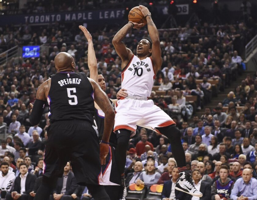 Toronto Raptors guard DeMar DeRozan shoots over Clippers center Marreese Speights in the first half.