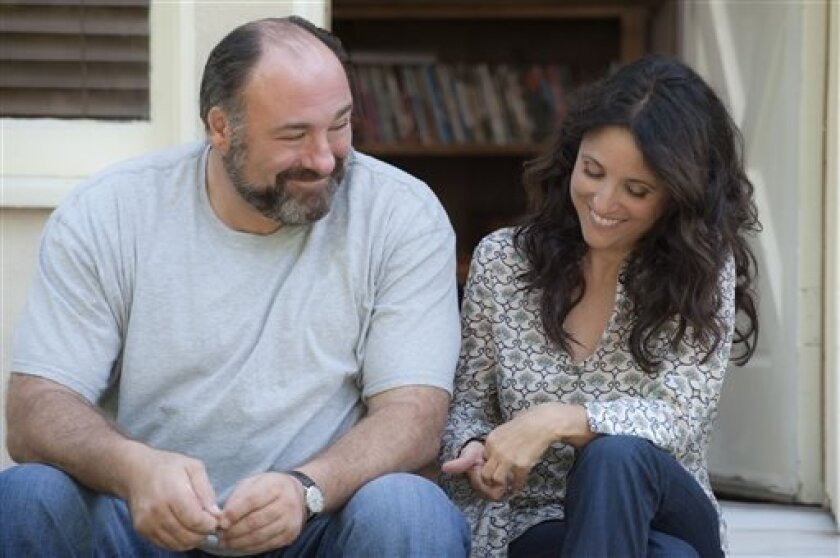 """This publicity image released by Toronto International Film Festival shows James Gandolfini, left, and Julia Louis-Dreyfus in a scene from """"Enough Said,"""" a film being showcased at the Toronto International Film Festival. (AP Photo/Toronto International Film Festival)"""