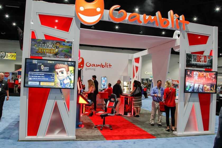 "With punchy graphics and emoji-like ""G head"" logo, the Gamblit Gaming exhibit was a popular draw at"