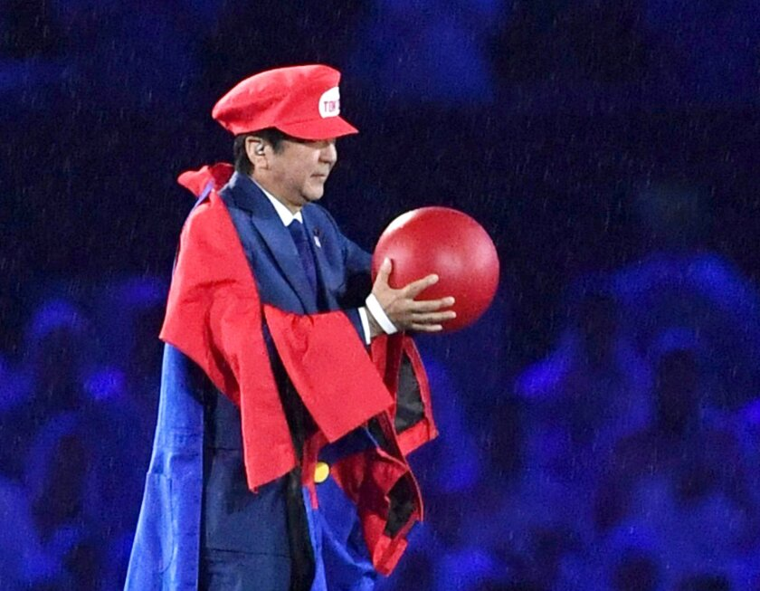 FILE - In this Sunday, Aug. 21, 2016, file photo, Japanese Prime Minister Shinzo Abe appears as the Nintendo game character Super Mario during the closing ceremony at the 2016 Summer Olympics in Rio de Janeiro, Brazil. Abe's brief but show-stopping appearance as Super Mario offered a glimpse at Tok