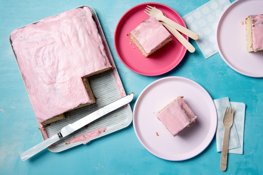 Pink-dyed frosting tops this classic vanilla cake