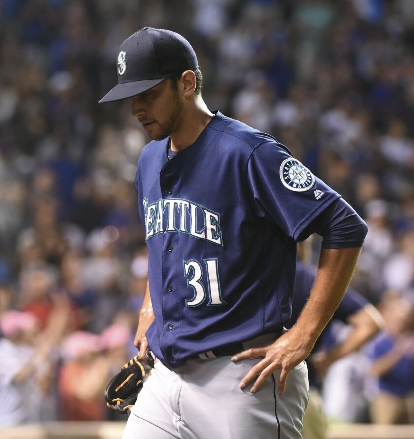 Seattle Mariners relief pitcher Steve Cishek (31) reacts after the Chicago Cubs tied the game 6-6 in the ninth inning of a baseball game on Sunday, July 31, 2016, in Chicago. (AP Photo/Matt Marton)