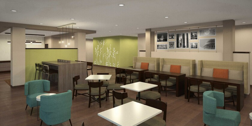 The common area of the new Sleep Inn design includes work spaces as well as cozy chairs and benches. (artist's rendering)