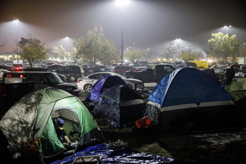 Evacuees from the camp fire set up a tent city at the Walmart parking lot in Chico, Calif.