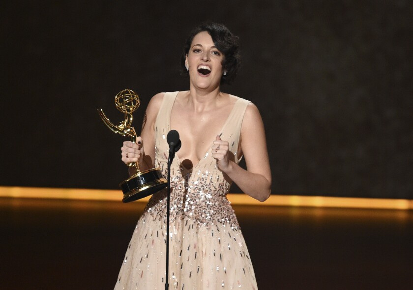"Phoebe Waller-Bridge accepts the award for writing for a comedy series for ""Fleabag"" at Sunday's Emmy Awards. Now she has a deal with Amazon."