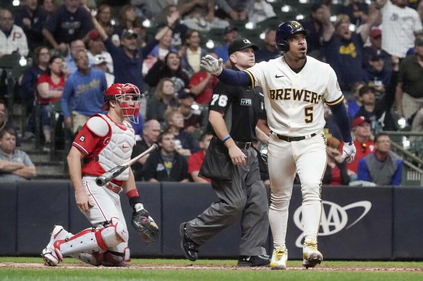 Milwaukee Brewers' Eduardo Escobar hits a home run during the sixth inning of a baseball game against the Philadelphia Phillies Wednesday, Sept. 8, 2021, in Milwaukee. (AP Photo/Morry Gash)