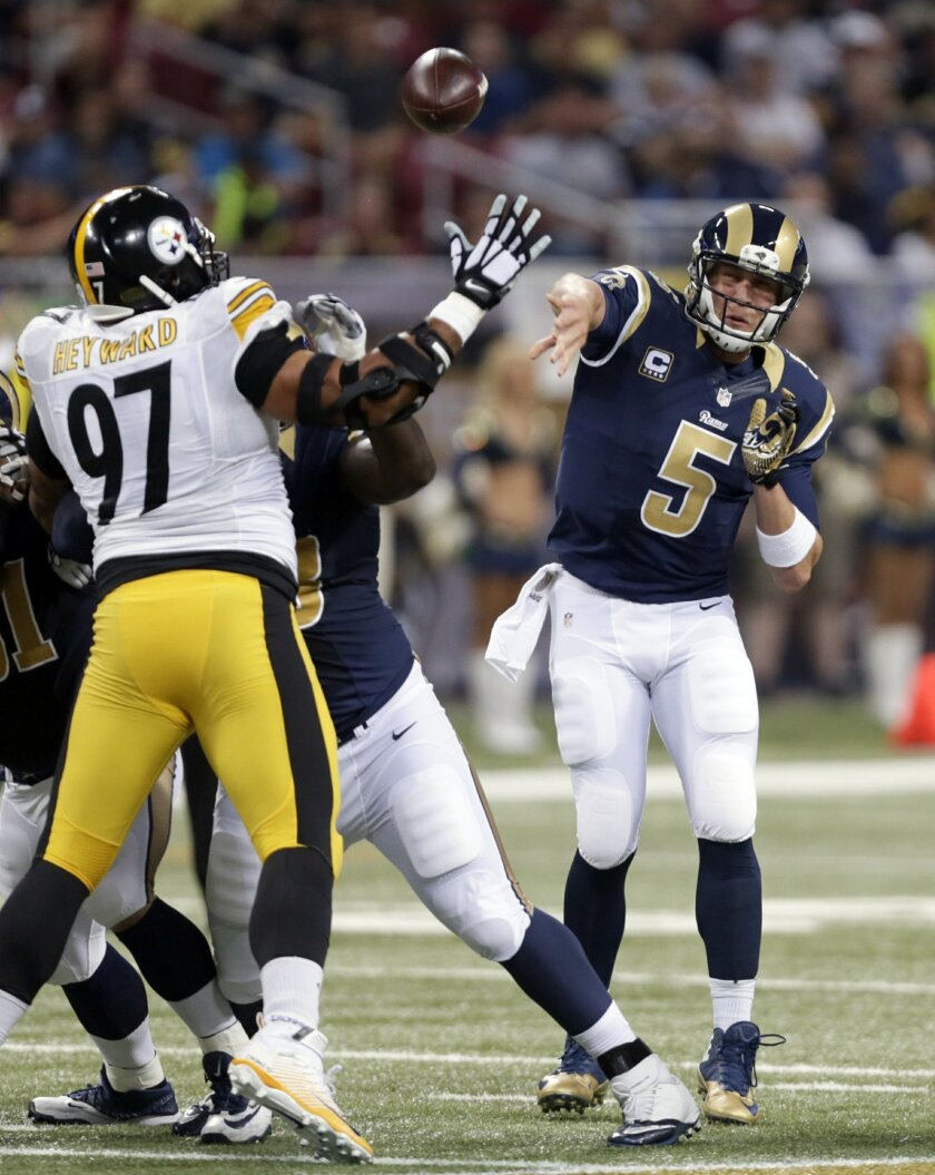 St. Louis Rams quarterback Nick Foles, right, throws over Pittsburgh Steelers defensive end Cameron Heyward during the first quarter of an NFL football game Sunday, Sept. 27, 2015, in St. Louis. (AP Photo/Tom Gannam)