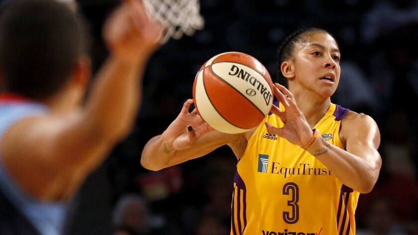 Sparks forward Candace Parker makes a no-look pass against the Dream during a win last month.